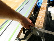 Lining up the rail to cut a jointable edge on the side of the countertop